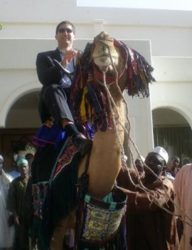 Trying out local transport. Todd looks a bit dubious of the Sultan's Camel
